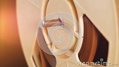 Rotação lenta da bobina de um gravador filme