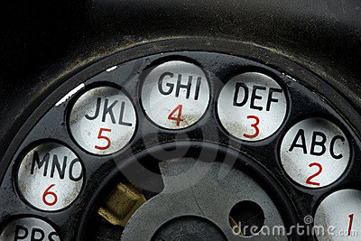 Rotary dial on old telephone