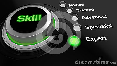 Rotary knob with the word skill in green turned to expert Stock Photo