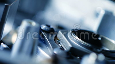Rotating of metal parts in a mechanical device. Spinning mechanism of car engine stock video footage