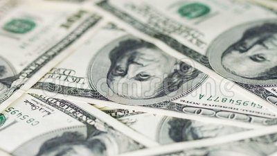 Rotating money in large denominations. United States dollars. UltraHD video - Rotating money in large denominations. United States dollars stock video