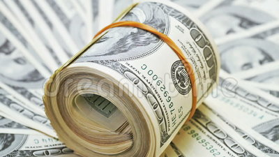 Rotating Rolled Up Bundle Of 100 Dollar Notes Stock Video