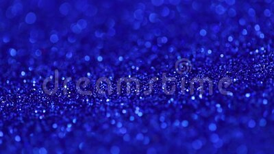360 rotation. Holiday shiny backdrop. Blue shiny surface with metallic sheen. Abstract beautiful blue background. Sparkles on the background stock footage