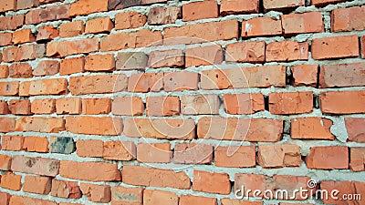 Rote Ziegelmauer und Steinmauer mit beschädigtem alten Ziegelstein, Hintergrund für Design stock video