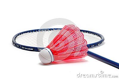 Rotes Badminton Shuttlecock (Piepmatz) und Schläger