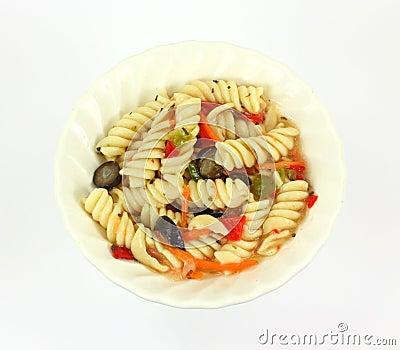 Rotini pasta salad in a small white dish