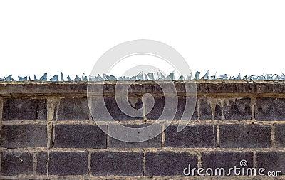 Rough brick wall and broken glass