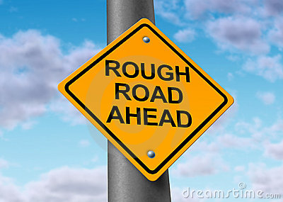 Rough road ahead street sign