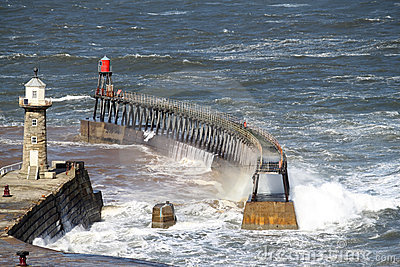 Rough sea at entrance to Whitby Harbour Yorkshire Editorial Photo