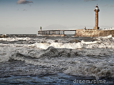 Rough sea with pier in whitby