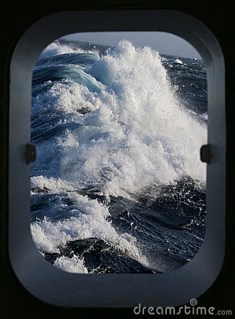 Rough sea through a ships porthole