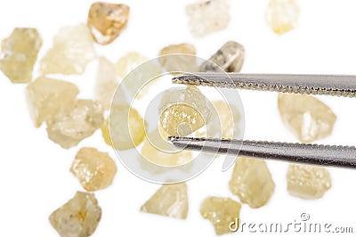 Rough uncut diamonds and tweezers