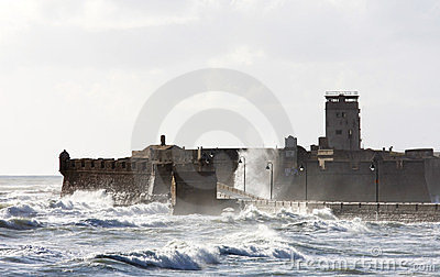 Rough waves around Castle of San Sebastian, Cadiz