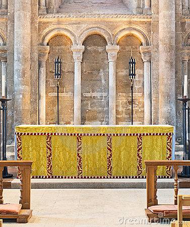 Round arches above an altar