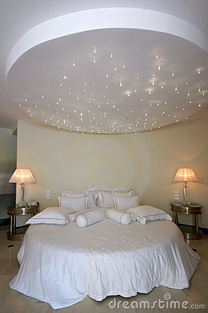 Round bed with stars lamp on the ceiling