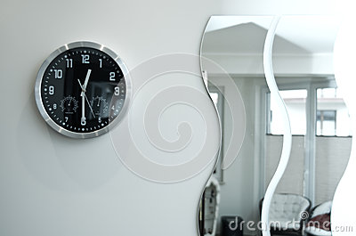 Round Black Wall Clock and Mirrors