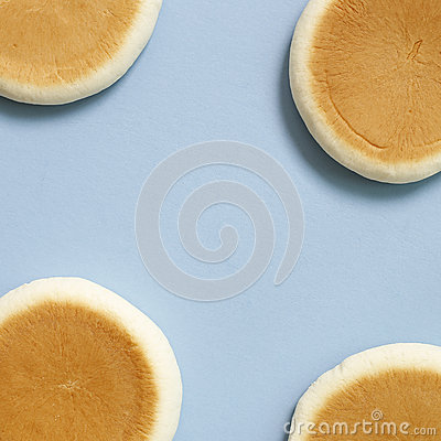 Free Round Bread On Blue Background Royalty Free Stock Photo - 84393325