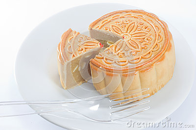 The round Chinese moon cake on dish