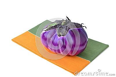 Round eggplant on a napkin