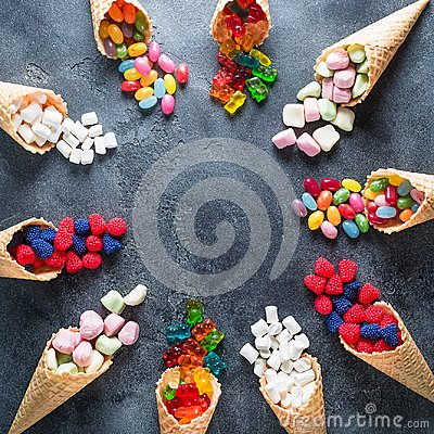 Free Round Frame Of Colorful Bright Assorted Candy In Waffle Cones On Dark Background. Flat Lay, Top View Royalty Free Stock Photos - 102754098