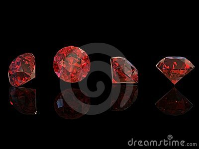 Round garnet isolated on black. Gemstone
