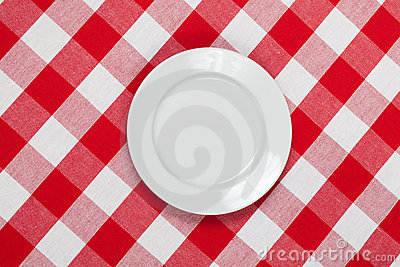 Round plate on red checked tablecloth