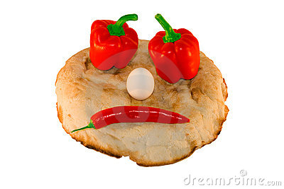 Round smiling bread with vegetables and eggs