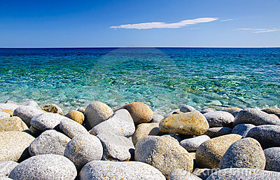 Round stones and clear sea