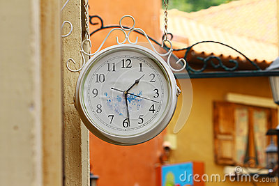 Round street watch hanging on the wall