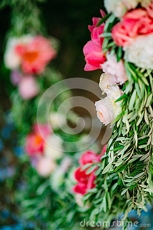 Free Round Wedding Arch Of Flowers And Olive Branches. Hanging On The Stock Image - 89264591