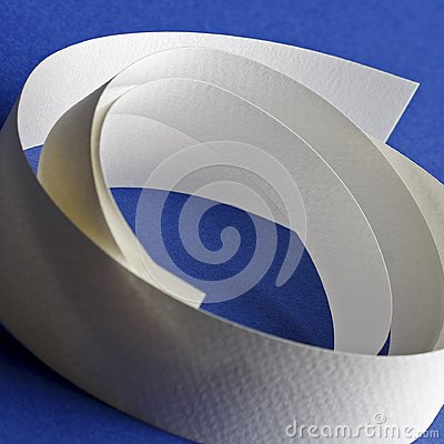 Round white textured paper strips on blue