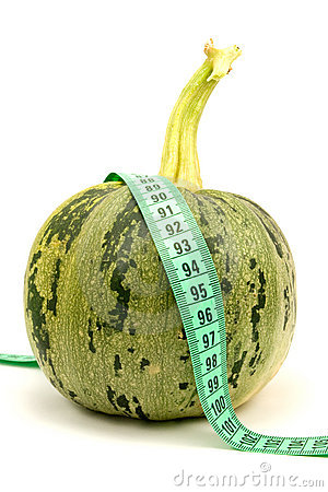 Round zucchini with measuring tape