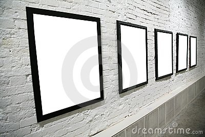Row of black frames on white brick wall