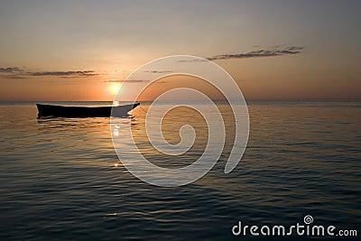 Row boat at sunset in zanzibar africa 1