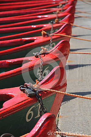 Row of boats with ropes and locks