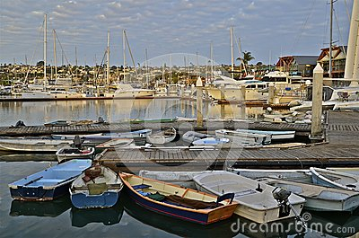 Row Boats and Yachts in a Harbor