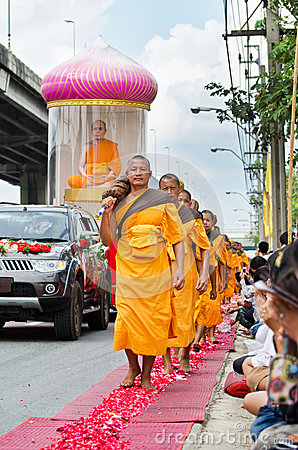 Row of Buddhist hike monks on streets Editorial Stock Image