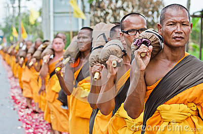 Row of Buddhist hike monks on streets Editorial Stock Photo