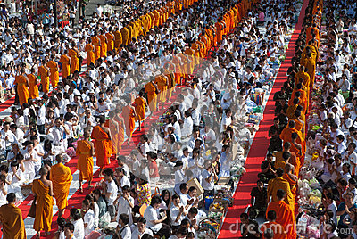 Row of Buddhist monks for peoples give food offerings. Editorial Stock Photo