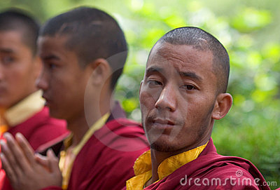 A row of Buddhist monks praying Editorial Image