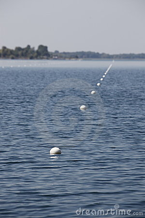 Row of buoys in sea