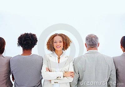 Row of businesspeople,Woman facing smiling happily