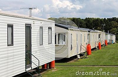 Row of caravan trailers in holiday park