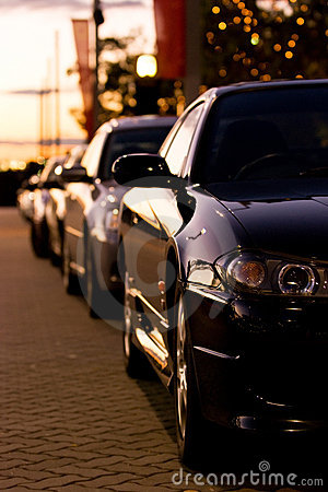 Row of cars at sunset