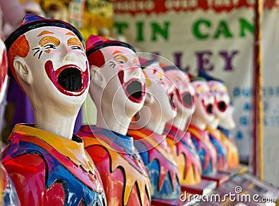 Row of clowns at fete or fair
