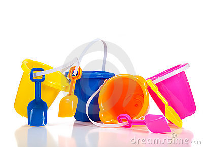 Row of colorful beach buckets or pails