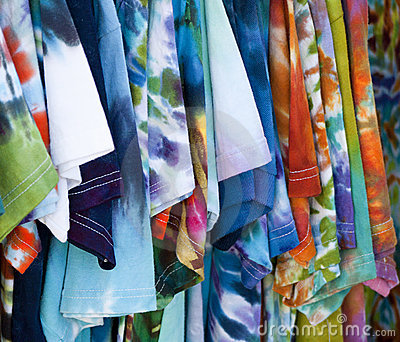Row of colorful patterned T-shirts hanging up