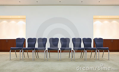 Row of comfortable chairs in waiting room