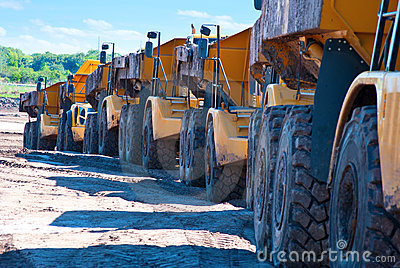 Row of dump trucks