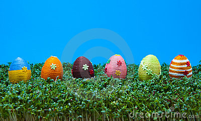 Row of easter eggs on cress